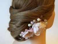 bun flower hair style for bridal