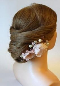 bun flower hair style for bridal